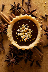Tart with milk chocolate  and cashew nuts