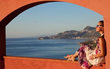 Fotobehang Blauwe hemel Happy brunette woman on vacation in Sicily
