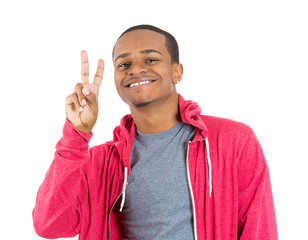 Happy young man giving a victory sign