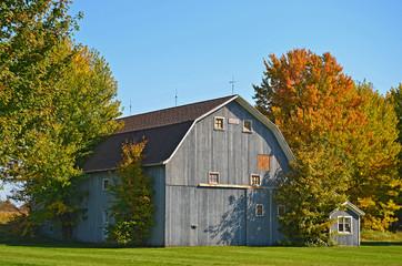 barn with autumn foliage