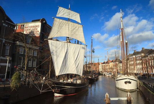 Sailing ships in a Dutch canal