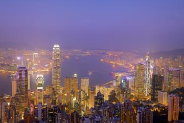 Hong Kong city skyline panorama at night with Victoria Harbor an
