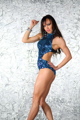 girl with muscular body in swimsuit with sequins
