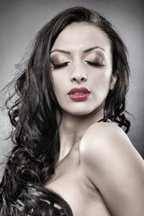 Sensual brunette with eyes closed