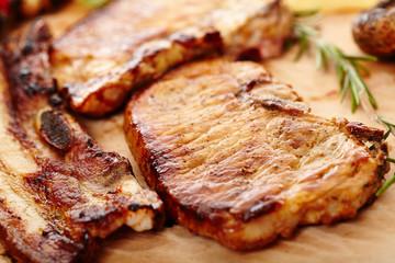 Fried pork meat on a wooden board