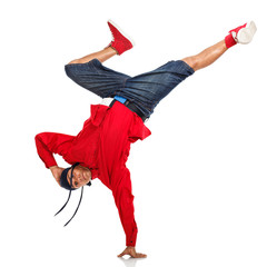 Hip Hop dancer doing one hand stand