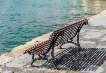 wooden bench on the promenade sea bay