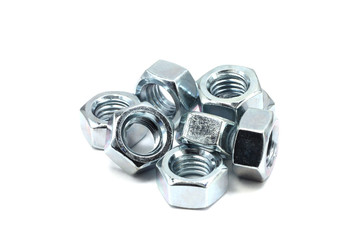Several anodized nuts on a white background