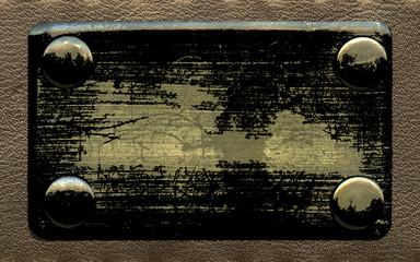 old blackened metal label
