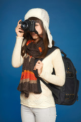Winter woman  traveler with photocamera