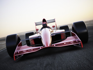 Acrylic Prints F1 Race car racing on a track front view with motion blur