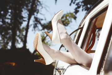 Brides legs out of vintage car