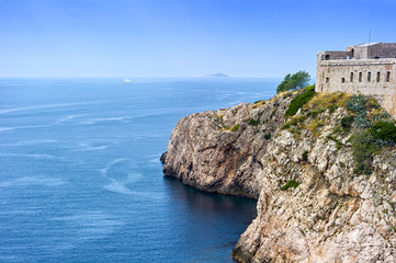 ancient fortress situated on a cliff above the sea