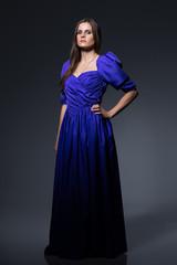 Beautiful princess in cute blue dress posing