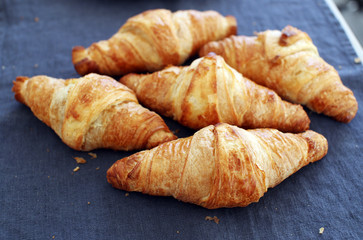 Cooking. Heap of croissants on the table