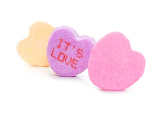 "Valentines Day Conversation hearts with ""It's Love"" text"