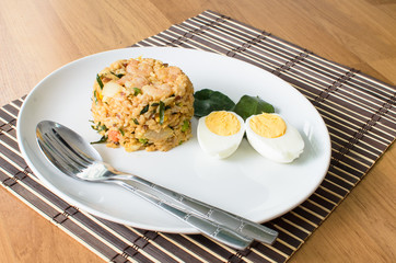 Khow Pat Tom Yum Koong  - Stir fried spicy rice with herbs and p