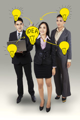 Businesswoman drawing light bulb