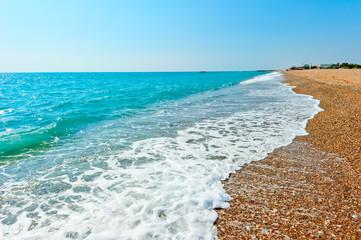 foam aqua and sandy beach