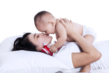 Young mother playing with her baby isolated