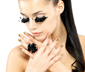 Woman with golden nails and style makeup