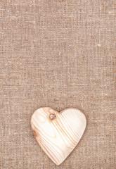 Wooden heart on the burlap
