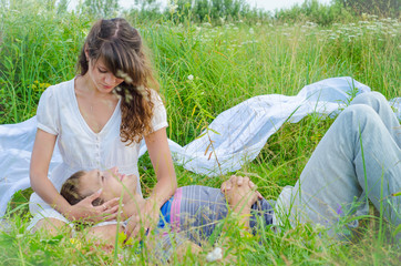 Young loving couple embracing in the grass