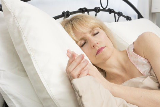 Sleep Time: Middle Age Woman Sleeping