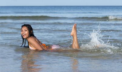 woman playing in sea