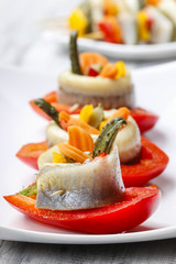 Pickled herring rolls with vegetables