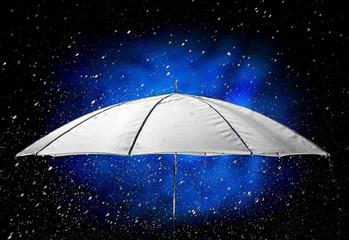 Umbrella under raindrops