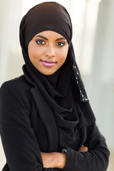 young muslim businesswoman with arms crossed