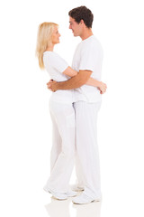 loving couple standing on white