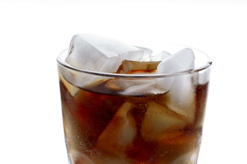 Cola with ice in glass