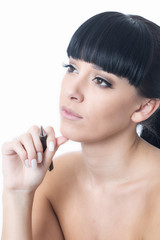 Thoughtful Young Woman Holding a Pen
