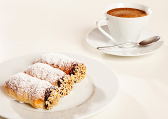Pastries and coffee cup
