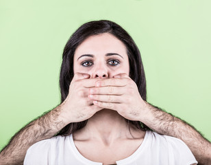 Man Covering Mouth of Woman with Hands