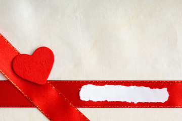 Valentines day background. Red satin ribbon and heart.