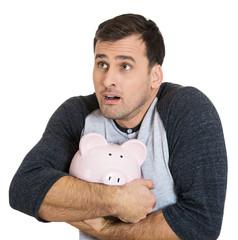 Savings protection concept. Man holding piggy bank