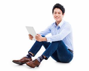 young Asian man having a smard pad PC