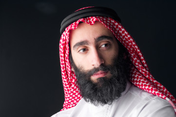 Portrait of a handsome young arabian man with a bushy beard