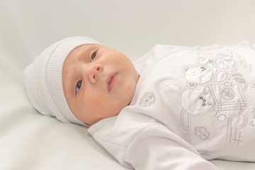baby in white a cap