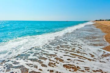 beautiful seascape. Sea foam on the shore