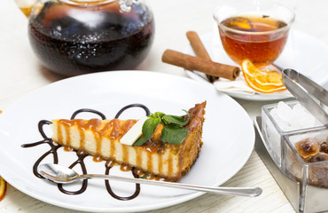 piece of cheese cake on a table in a restaurant