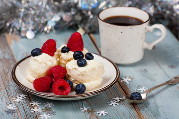 Coffee and Christmas dessert with fresh berries