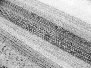 snow-covered road with tire tracks, detail