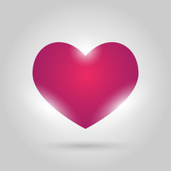 glowing pink heart on gray background