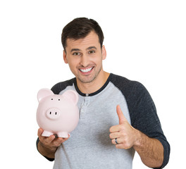 Portrait young man holding piggy bank, white background