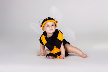 Beautiful baby dressed in a bee costume