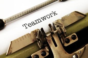 Teamwork text on typewriter